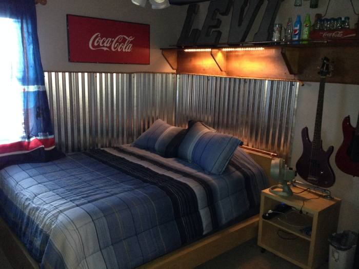 Teen Boy Room: industrial, corrugated steel wainscoting, coke, signs, copper rail, bottle collection